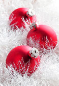 Red christmas baubles — Stock Photo