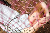 Young red-haired female relaxing in hammock — Stock Photo