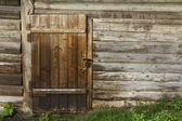 Old wooden wall and door with rusty lock — Stock Photo