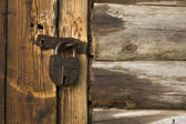 Old wooden door with rusty lock — Stock Photo