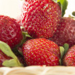 Clouse-up of fresh strawberries in a small basket — Stock Photo