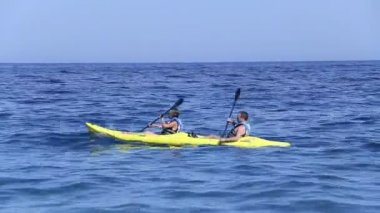 Couple kayaking in the sea. Start of the season in Greece, May 2014 — Stock Video