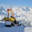 Stock Photo: Rescue snowmobile on alps