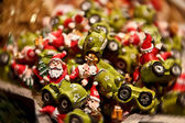 Santa riding his little green Race Car — Stock Photo