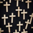 Stock Photo: 25 wooden crosses suspended on black canvas