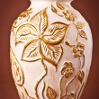 Ancient clay vase on brown background — Lizenzfreies Foto