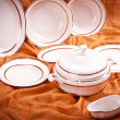 Stock Photo: Dinnerware set on orange background