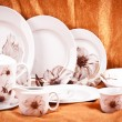 Dinnerware set on orange background — Stock Photo