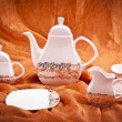 Dinnerware set on orange background — Stock Photo #35750475