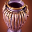 Ancient clay vase on brown background — Stock Photo #35752991