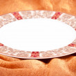 Plate on orange background — Stock Photo #35755685