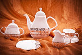 Dinnerware set on orange background — Stok fotoğraf