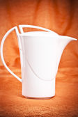 Teapot isolated on orange fabric background — 图库照片