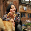Rural Chinese girl aged 8 years hugging red, street, mixed-breed - Foto de Stock