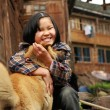 Rural Chinese girl aged 8 years hugging red, street, mixed-breed — Stock Photo