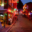 Stock Photo: Night Yangshuo Town. Yangshuo West Street at night - tourist meccof South West China. Attractions in South China, popular with tourists from all over world. Yangshuo at night attracts tourists.