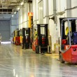 Forklift Trucks in stock. Corridor large warehouse. — Stock Photo