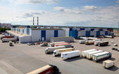 Cargo terminal in a large warehouse complex. Trucks unload, unlo — Stock Photo