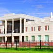 Administrative building of two stories high, white, with columns, lined with tiles. — Stockfoto
