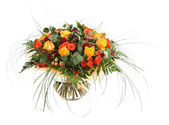 Floral composition of orange roses, hypericum and fern. Flower arrangement in a transparent glass vase. Isolated on white. — Stock Photo