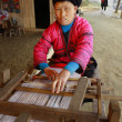 Red Yao Women in Xiaozhai Village, Longsheng County, Guangxi Province, China. Woman red Yao nationality, ethnic minority groups in China,  weaves on an old loom made of wood, April 4, 2010. — Stock Photo