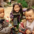 Three Chinese children having fun near the farmhouse, Basha Miao Village, Congjiang County, Southeast Guizhou Province, Southwest China — Stock Photo