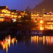 Stock Photo: Night lighting constructions in Chinese village of ethnic minorities.