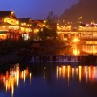 Night lighting constructions in Chinese village of ethnic minorities. — Stock Photo #31127899