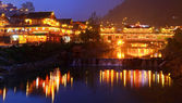 Night lighting constructions in the Chinese village of ethnic minorities. — Stock Photo
