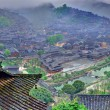 Stock Photo: Fog and clouds in big mountain village in southwest China.
