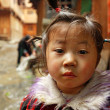 Asian girl 4 years old, close-up portrait on rural street. — Stock Photo