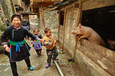 Family with children of Chinese farmers, stands near the pigsty. — Stock Photo