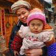 Stock Photo: Rural family of Asia, father holding baby in her arms.