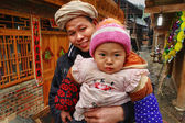 Rural family of Asia, father holding baby in her arms. — Stock Photo