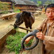 Asian Village, Rural Chinese peasant farmer is holding horse-collar. — Stock Photo