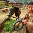 Asian Village, Rural Chinese peasant farmer is holding horse-collar. — Stock Photo #35547681