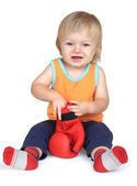 Baby boy in orange, sitting with red boxing gloves. — Stock Photo