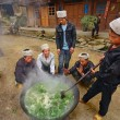 Men Asians, Chinese peasants, farmers, cook on  rural street village. — Stock Photo