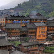 Stock Photo: Wooden building rural hotels in Chinese village of ethnic minorities.