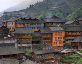 Wooden building rural hotels in Chinese village of ethnic minorities. — Stock Photo