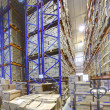 Interior storage warehouse, stacked shelving shelves with cardboard boxes. — Stock Photo #37843607