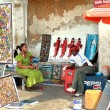 Stock Photo: Africsouvenirs, Art shop outdoors, bright paintings sell, dark-skinned sellers.