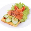 Belgian waffle with sliced salted salmon, tomatoes, cucumbers, l — Stock Photo #38676227