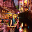 Night Cafe on balcony, near water, in small town Yangshuo. — Stockfoto #38843935