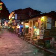 Night narrow street in small town Yangshuo, cafes, restaurants, hotels. — Stock Photo