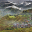 Stock Photo: Rural China, peasant village in countryside, mountain region, rice paddies.