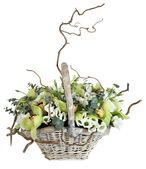 Flower arrangement in wicker basket, bouquet of orchids, lisianthus, eucalyptus. — Stock Photo