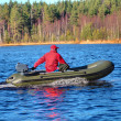 Green, powerboat, inflatable rubber boat with motor on wood lake — Stok fotoğraf