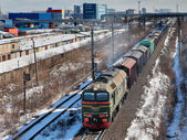 Goods train carries cargo on railway track, Russia. — Stock Photo