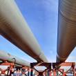 Above-ground pipeline, lower shot against blue sky — Stock Photo